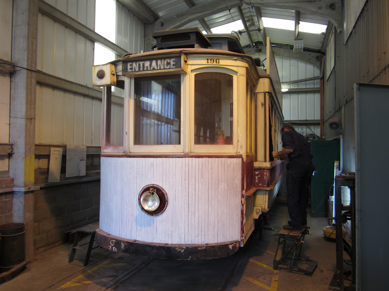Newly reunited with its refurbished truck, 196 is seen here in the lean-to shed at Beamish with its dash panel already in undercoat and side panels being removed. (Photo courtesy of the Beamish Transport & Industry Blog)