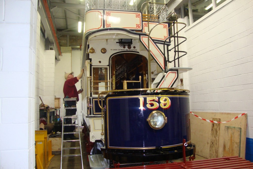 Seen in the workshop extension, LUT 159 is shown receiving its final exterior varnish, and looking absolutely fantastic. (Photo courtesy of the Crich Tramway Village blog)