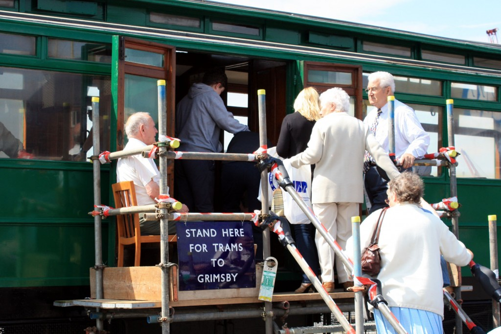Visitors to the Immingham 100 event seen enjoying a rare gimpse inside the last surving original Grimsby & Immingham tram. (Photo by Malcolm Slater)