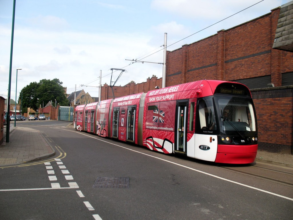 211 carries a special livery for the Armed Forces Day held in Nottingham at the end of June. The tram is seen here on Terrace Street.
