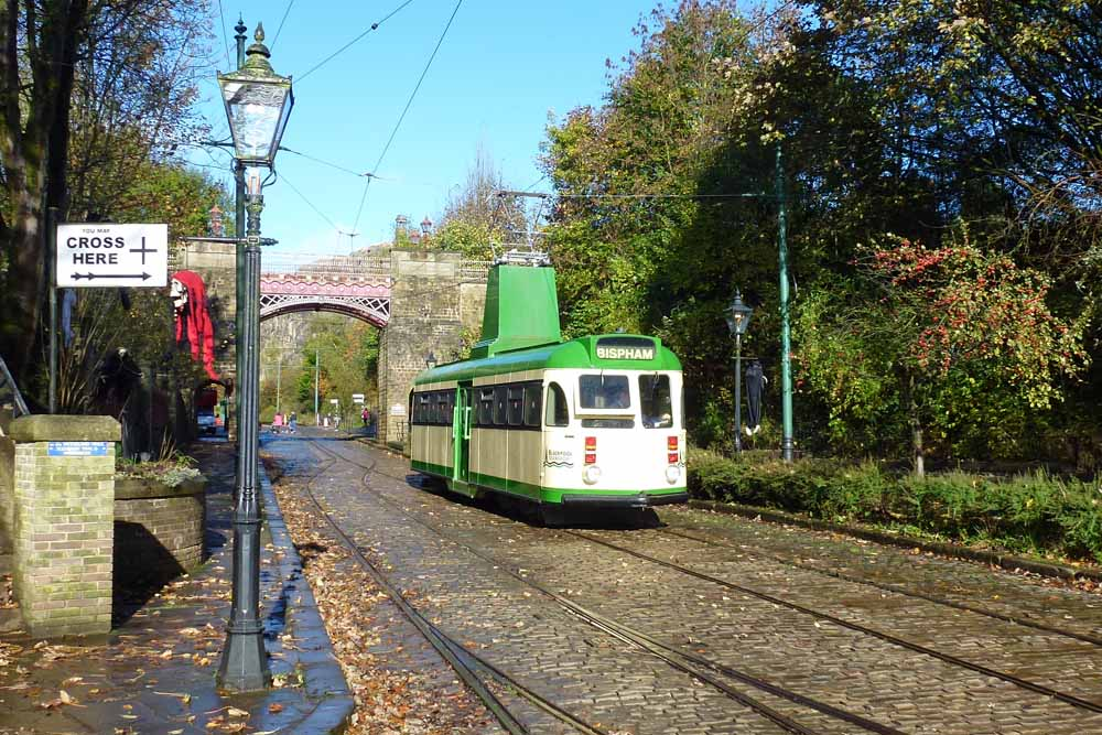 A sunny view from early in the day, showing Blackpool Brush car 630 in service as the first Halloween decorations start to appear around the village site.