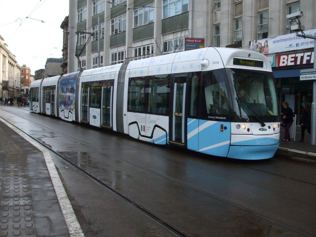 209 seen at Old Market Square carrying its new all over advert for Interski. As can be seen two of the five cars of the tram have received no extra vinyls at all with the two end cars only receiving limited adverts.