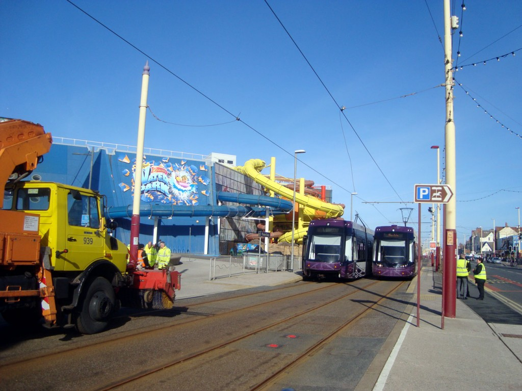 015 sits in the platform at Pleasure Beach with sister 011 for company as the Unimog looks on.