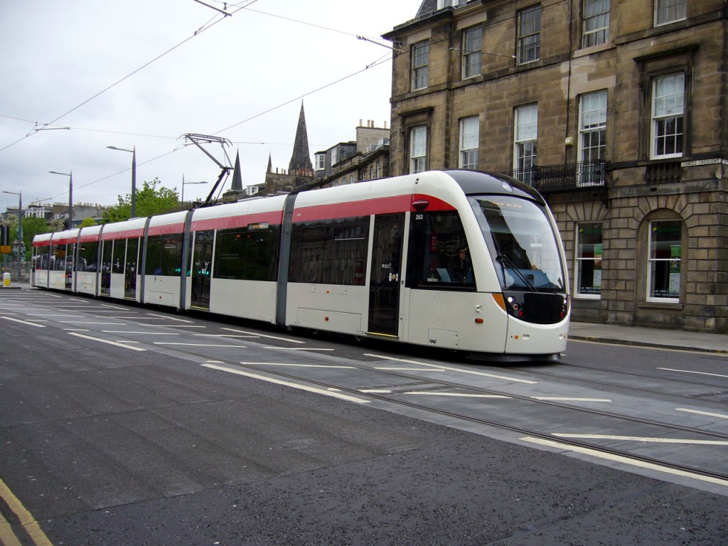 """Although the majority of the Edinburgh Trams fleet have received the latest livery style the """"as delivered"""" style is still carried on at least one vehicle - 262. This tram has been used on testing several times over the past few days and is seen in this photo having just left the Princes Street West tram stop and is passing through Coates Crescent and about to enter Shandwick Place heading for Princes Street and thence the York Place terminus. (Photo: John Hampton)"""