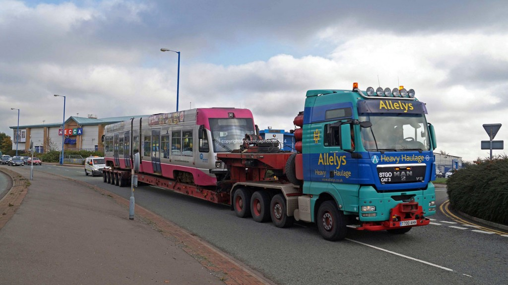 Images showing 07 on the back of the low loader as it is backed out of the depot and then sets off to storage. (All Photos: Andy Walters)