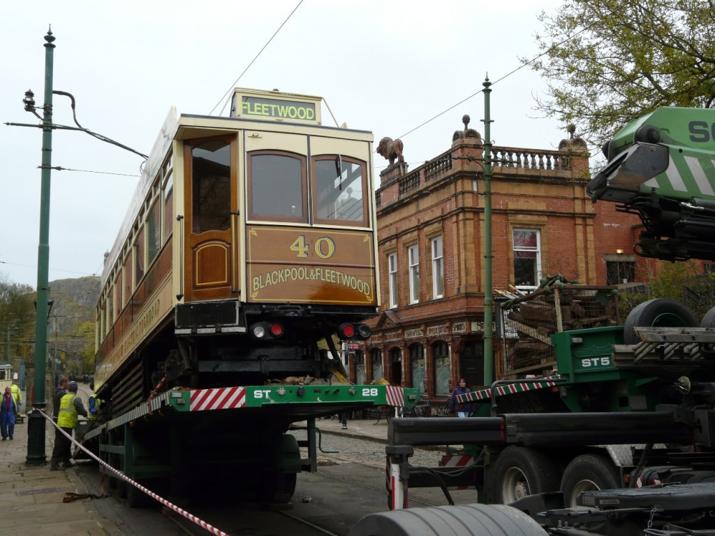 The extent of the slope on the trailer used to transport Box car 40 to Blackpool is shown to full effect as the tram waits to bid farewell to the museum in the shadow of the Red Lion.
