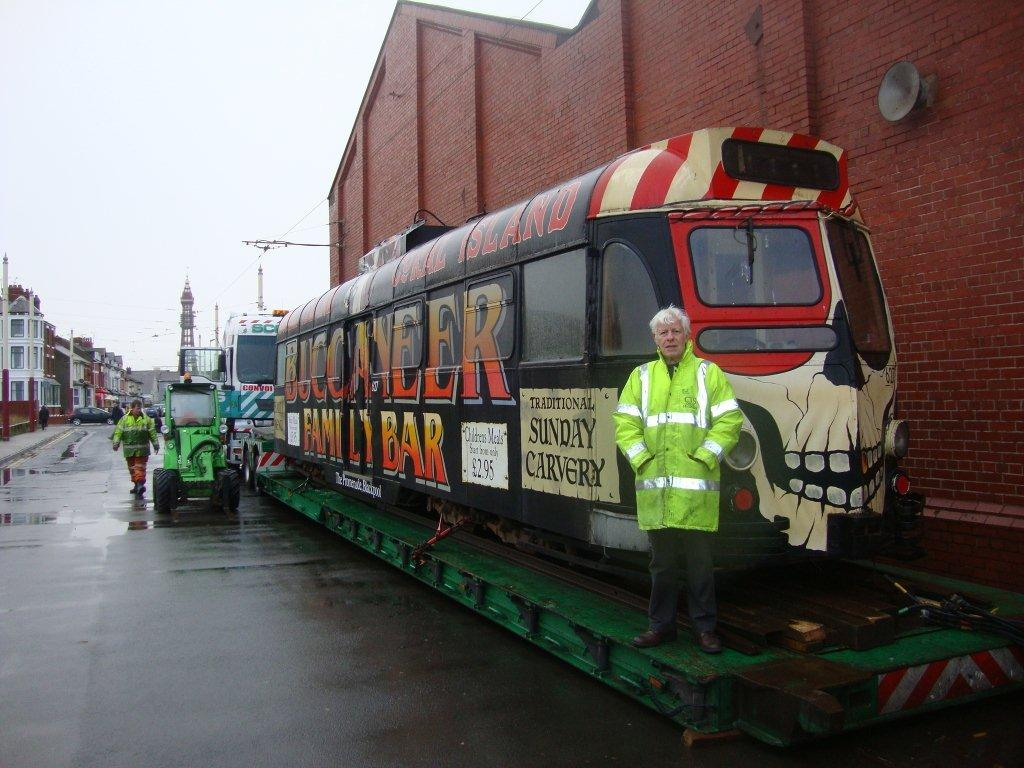 The four different looks of 290. When acquired by the Fleetwood Heritage Leisure Trust the tram was in this all over advert for the Bucaneer Bar at Coral Island. Here FHLT trustee Colin Macleod is seen alongside the tram as it is loaded on Blundell Street.