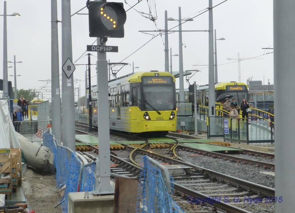 This is the city end of the layout with inbound trams ready to depart from both the dedicated inbound  and the bi-directional centre platforms. In the foreground 3093 is leaving for Ashton and behind in the inbound platform 3012 heads a double unit waiting to leave for Bury.
