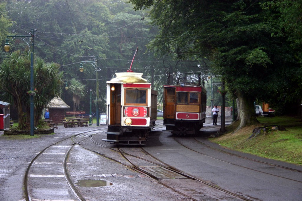 A typical summer view at the old Laxey Station on 14th August 2013 as the Manx Electric Railway's 6 hauls trailer 41 with Snaefell Mountain Railway 5 racing alongside. (Photograph by Gareth Prior)