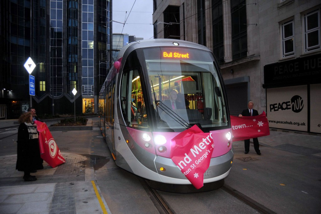 35 becomes the first public service tram on the streets of Birmingham since 1953 as it breaks the banner.