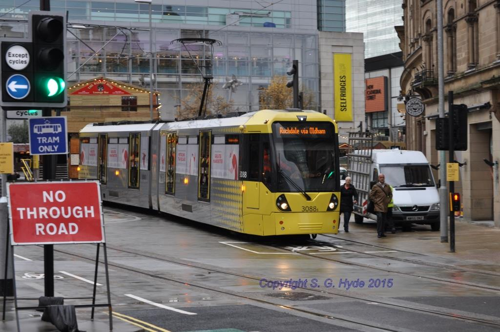 3088 departs from Exchange Square with the first northbound trip on the 2CC to Rochdale. Note the temporary signage informing other road users not to drive their car onto the tracks! (Photographs x2 by Steve Hyde)