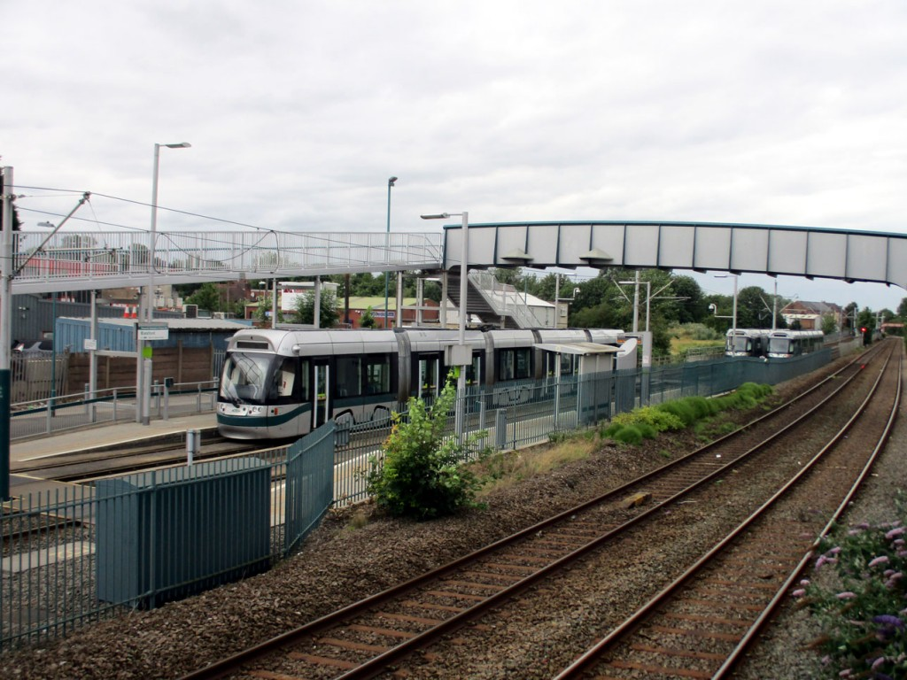 Basford tramstop with the stricken 213 standing in the platform on 21st July. In the distance a further two Incentros can be seen, both with pantographs up.