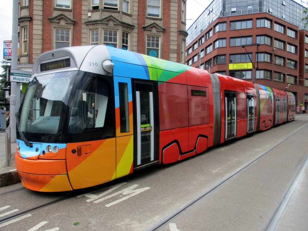 Carrying a mainly red livery with splashes of blues, greens and oranges 210 is certainly a colourful tram now. It is seen here at Royal Centre on 13th July when working through to Phoenix Park. (Photograph by Bob Gell)