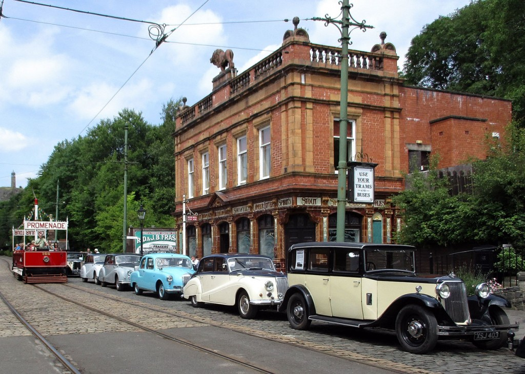Blackpool 166 passes The Red Lion and a queue of parked cars.