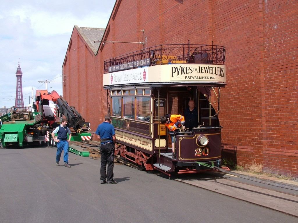 The moment of truth as for the first time ever, a Birkenhead tramcar makes contact with Blackpool tracks as 20 is carefully unloaded onto Blundell Street.