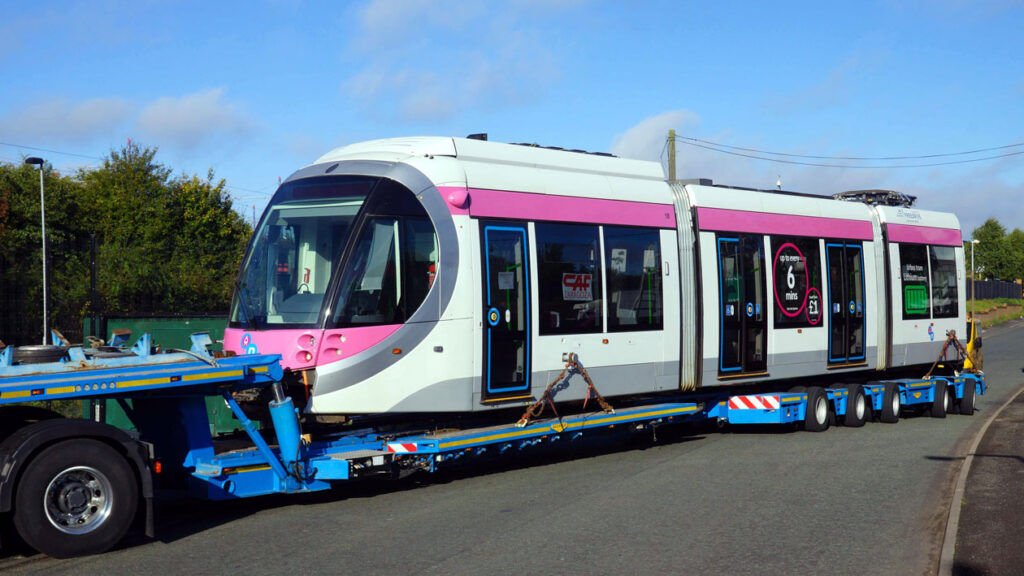 18 arrives at Wednesbury. The batteries are installed on the roof on the first section of the tram.