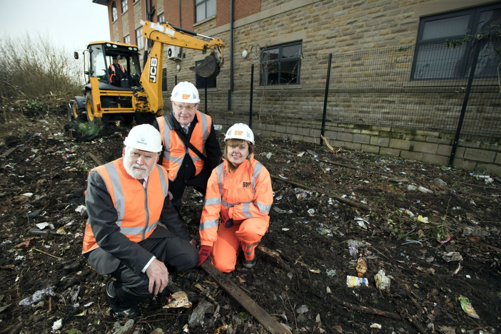 Lewis Lesley and Lincoln Shields from Preston Trampower are joined by Eric Wright Civil Engineering's Diana Bourne at the Preston Muslim Girls High School for the sod-cutting ceremony. This sight is adjacent to the site of the planned tramway. (Photograph courtesy of Preston Trampower)