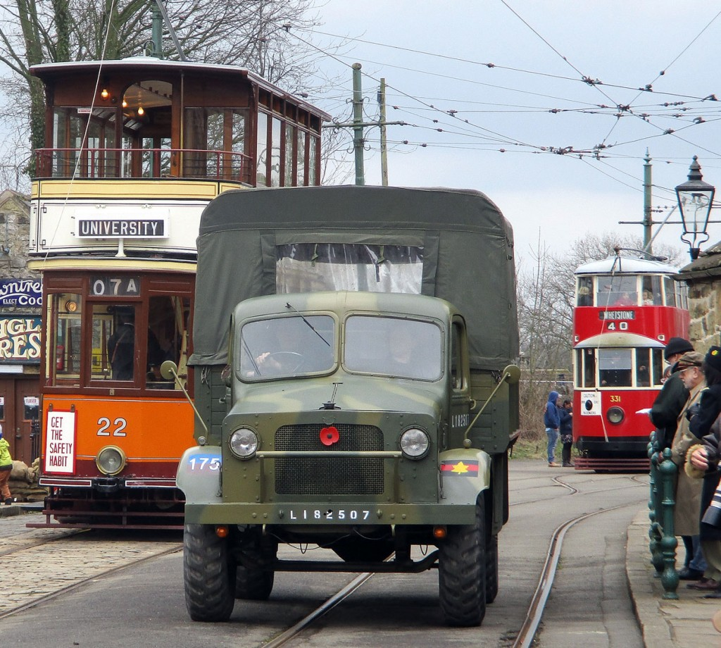 As a military vehicle approaches the camera Glasgow 22 waits at Stephenson Place with MET 331 down at the Town End stop.