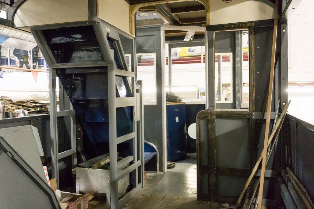 An interior view of the lower deck shows the cab end bulkheads, although there remains much fitting out to do. Even the staircases are blue!