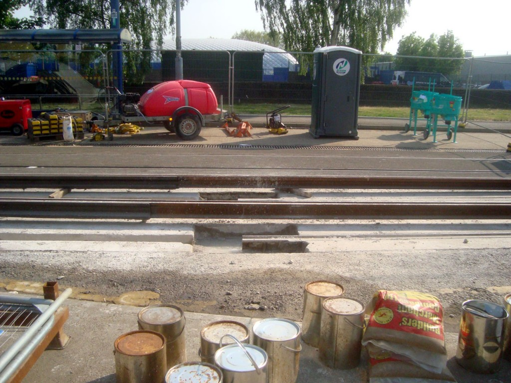 A side view of the rails waiting to be lowered into the groove ready for their installation.
