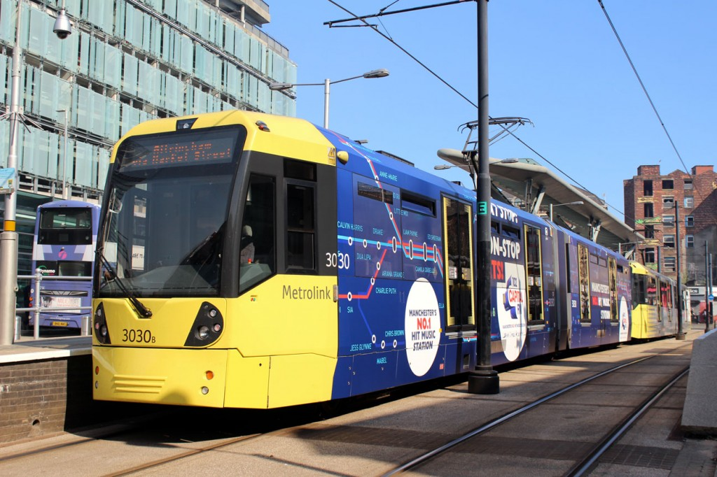 3030 is seen here at Shudehill on 27th June in its new advert for Capital Radio.