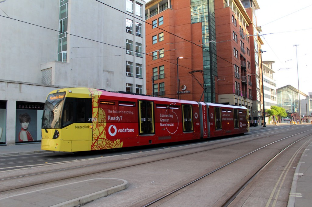 The Vodafone vinyls on 3100 as it heads away from St Peter's Square with a service from Victoria to Manchester Airport on 26th June. (Both Photographs by Gareth Prior)