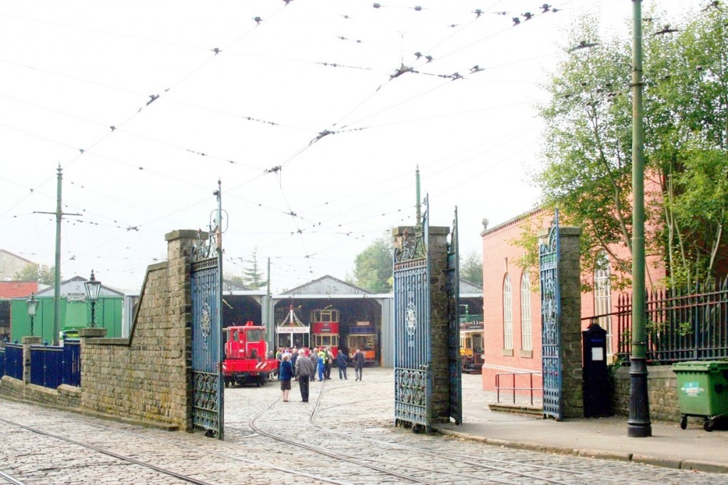 The depot entrance with a number of trams visible both in the depots and in the yard.