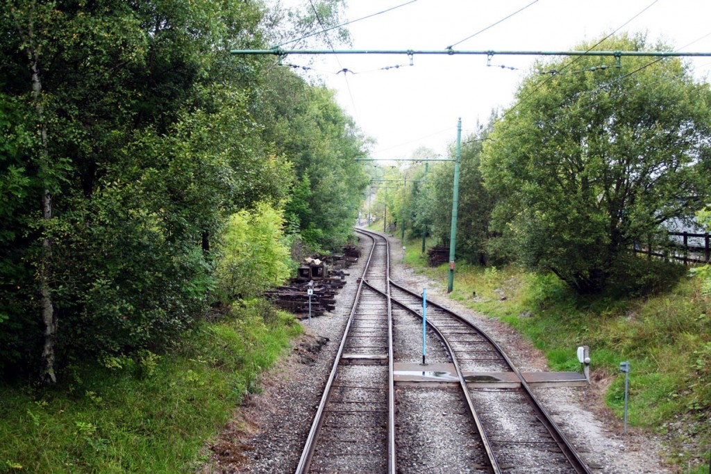 Where the double track changes to single with the blue pole in th centre of the shot being where the single line token is placed.