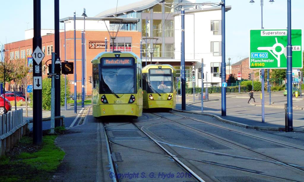 On the approach to the Ashton terminus we catch 3042 departing towards MediaCityUK as 3061 waits to enter the terminus having come from Eccles.