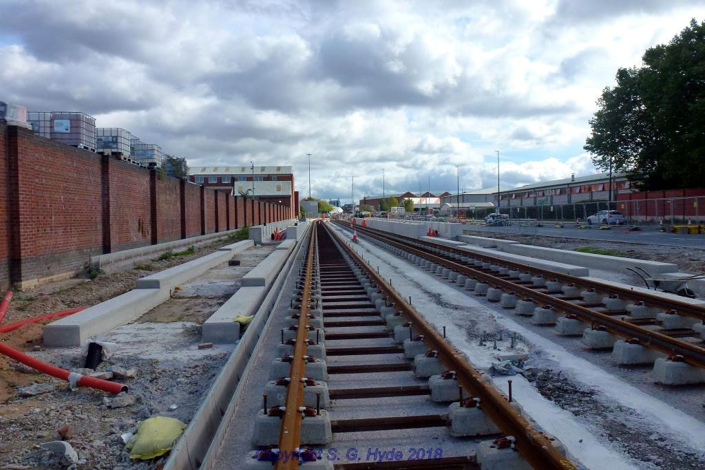 This shot was taken at the west end of Village stop and shows track laid right through the stop with the platform structure clearly visible.