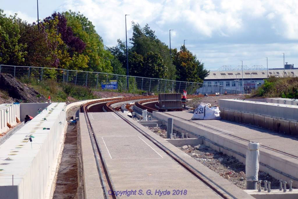 We have now moved along to the western end of Village Way and this photograph shows track at Park Way stop. The track is fully embedded and most of the platform structure is in place as at Village stop.