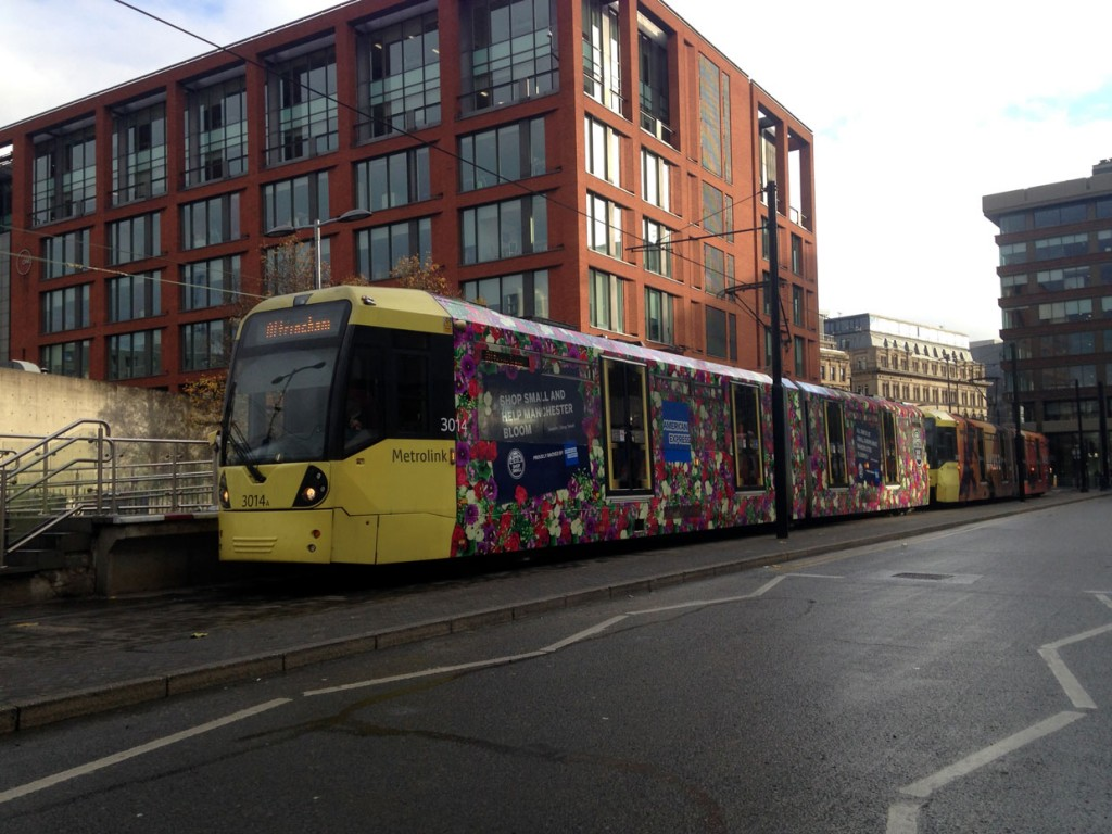 The very floral design on 3014 is seen here at Piccadilly Gardens on 25th November 2018. The tram is operating as a double to Altrincham with fellow vinyl wrapped tram 3007 (advert for Mars 2).