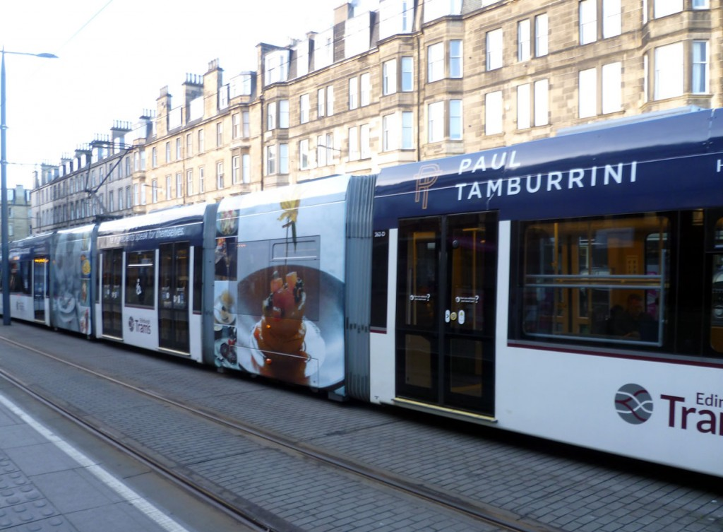 A view of the Paul Tamburrini side of the Macdonald Hotels tram 262. This restaurant is at the Macdonald Holyrood Hotel in Edinburgh , almost next to the Scottish Parliament. The tram is pictured at Haymarket and is citybound.