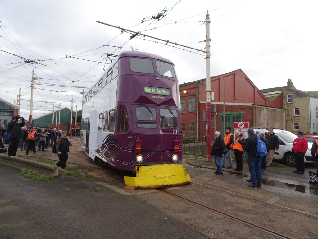 Snowplough-fitted Balloon car 711 emerges from the depot on Saturday morning for shop duty at North Pier, surrounded by enthusiasts eagerly awaiting the start of the Branch Line Society tour.