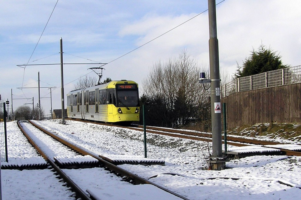 3025 approaches Newhey with a service for East Didsbury. A light dusting of snow remains on the ground.