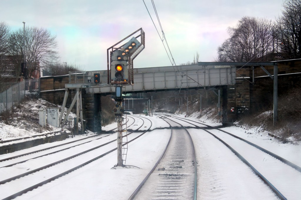 Picture from the front of 4088 as it approaches Heworth with the signal indicating that it will work wrong way into Platform 2 via the cross-over that can be seen in the distance. Platform 2 would be its normal platform for the return trip. The lines on the left are the National Rail lines down the Durham Coast.
