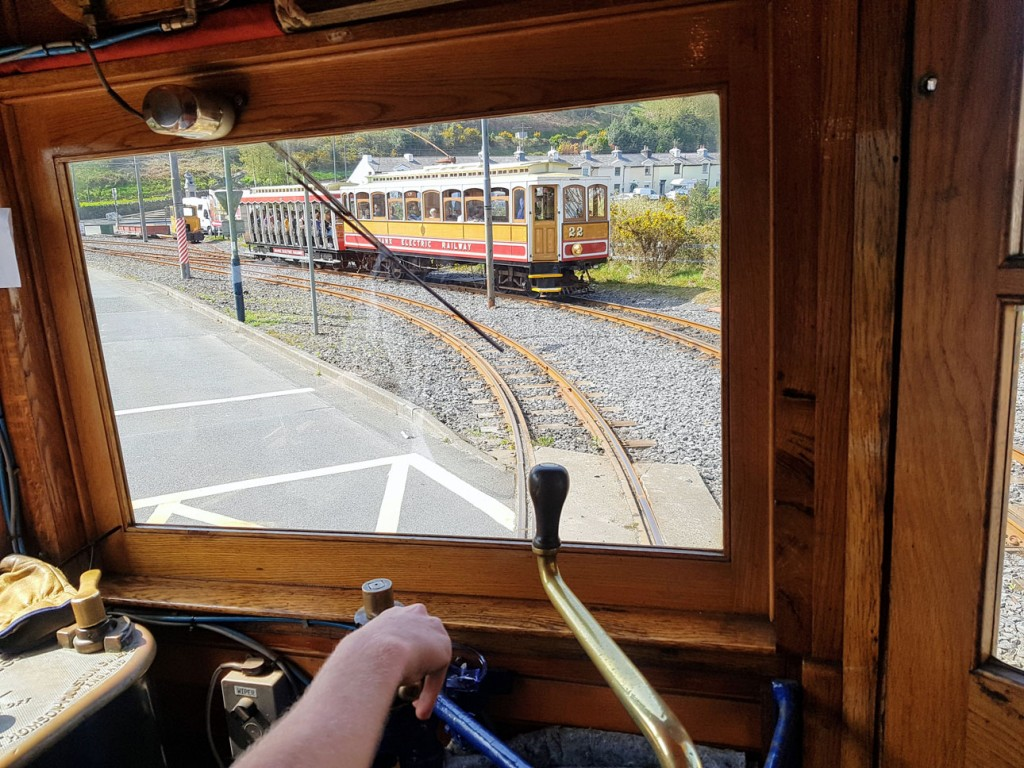 This time we are definitely looking through a rectangle window – the windscreen of 7 – at Winter Saloon 22 and trailer 47 as they pull away from Laxey. (All Photographs by David Maxwell, 20th April 2019)