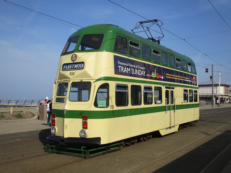 723 pauses at the North Pier and Tower heritage tram stop on an exceptionally sunny Easter Sunday - its first day out adorned with Tram Sunday adverts.