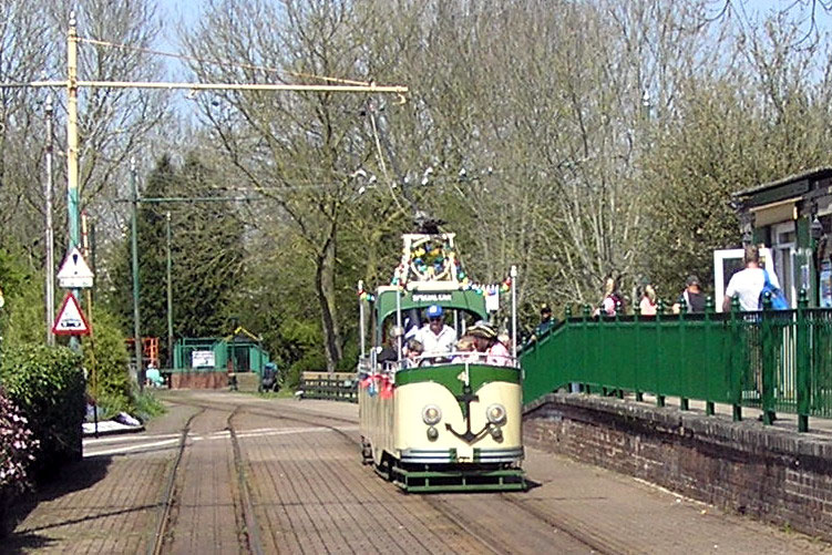Very rarely used is the Blackpool Boat style tram, no. 4. But it is the tram of choice for the Pirate Tram – aka Seaton Pearl – and is seen here on one such occasion as it just heads away from Colyton.