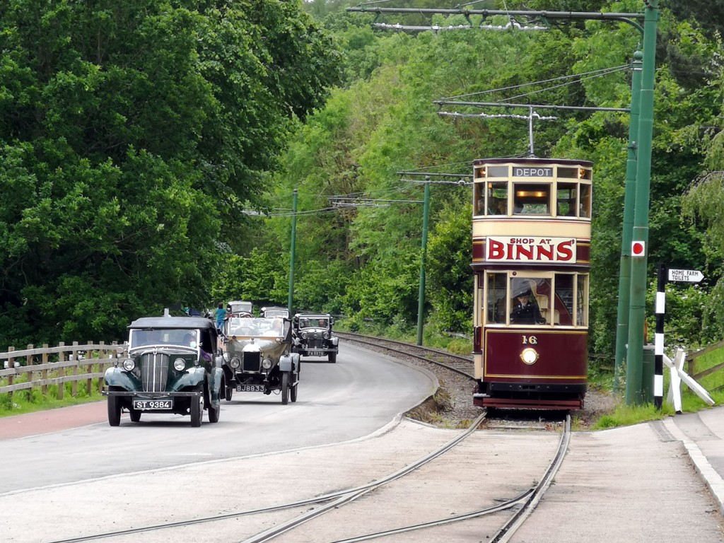 Sunderland 16 approaches the stop at Foulbridge for Home Farm and the Colliery. Alongside a parade of cars present for the Morris Car Rally pass by on the road.
