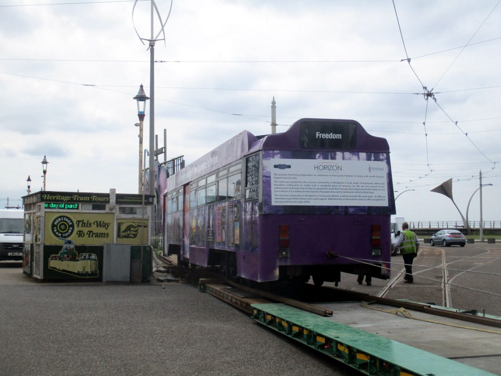 641 is winched aboard the low loader bringing an end to its four year stay at Pleasure Beach.