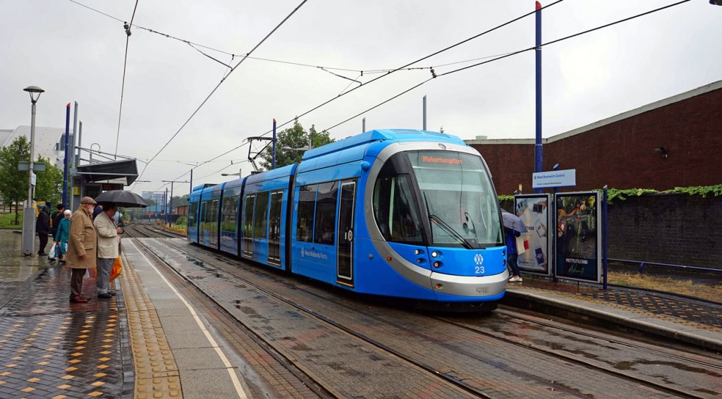 The first day in service for 23 in its new livery was a wet 27th July. The tram is seen here at West Bromwich Central as it heads to Wolverhampton St George's. This stop also has the new brand in place now. (Photograph by Andy Walters)