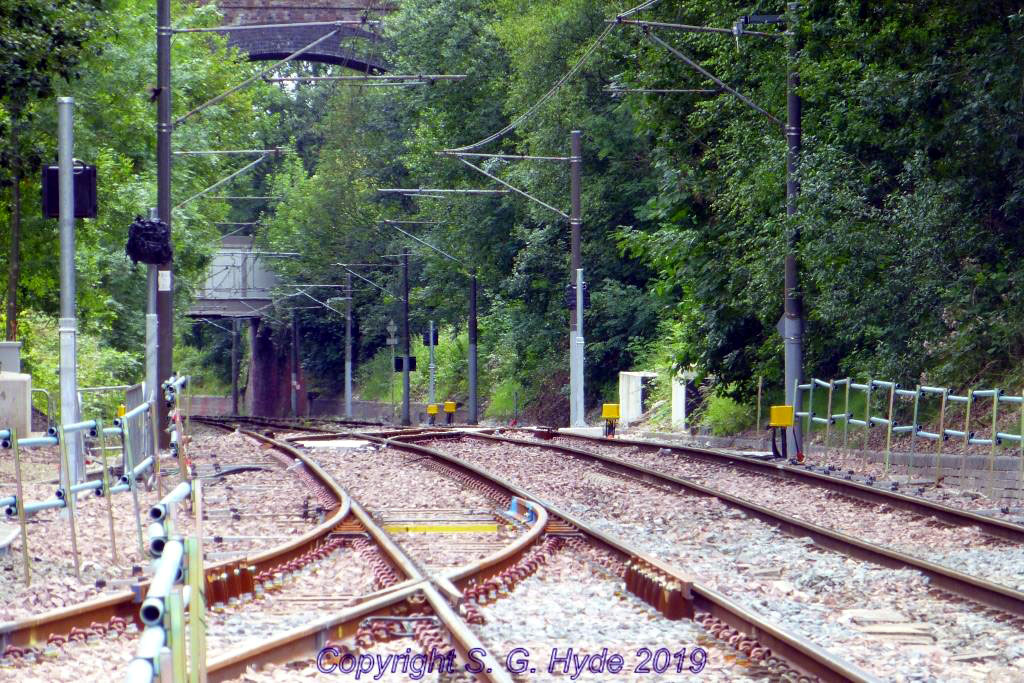 A view looking towards Manchester with newly erected signals and point indicators visible along with more axle counter equipment. The points associated with the crossover have had point machines fitted.