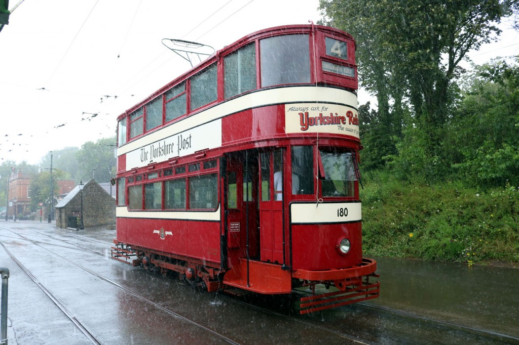 During a very heavy downpour Leeds 180 waits at Town End.