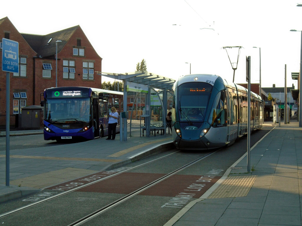 Citadis 225 arrives at Beeston Centre with a service for Hucknall. The layout at Beeston Centre sees the tram platforms separated by the road with a raised platform also provided for buses as kindly demonstrated for us here by a Trent Barton vehicle.