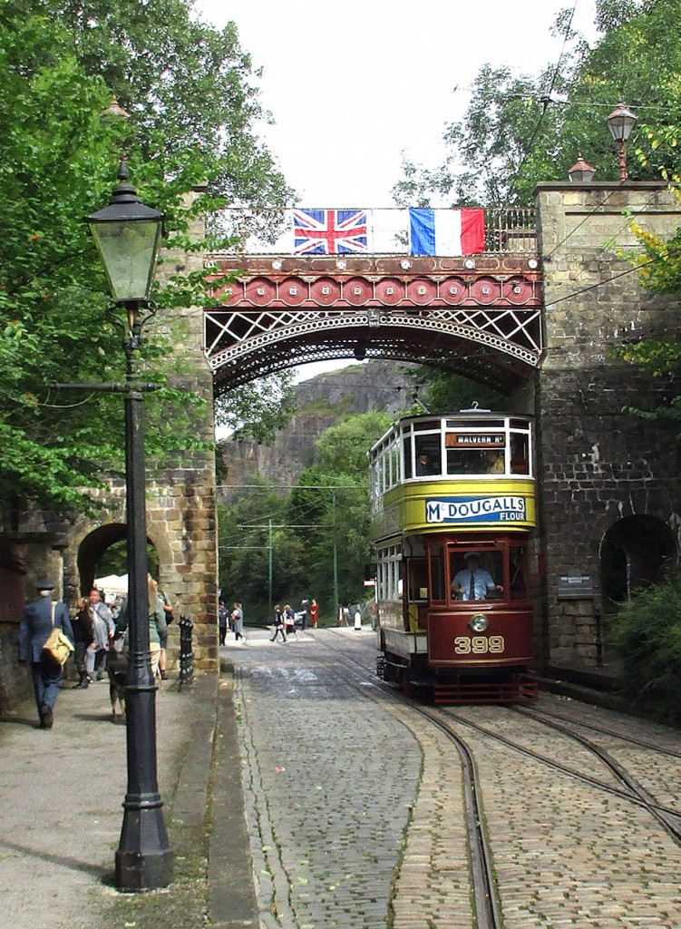 Leeds 399 passes under Bowes Lyon Bridge heading down to Stephenson Place. Note the Union and French flags draped from the bridge.