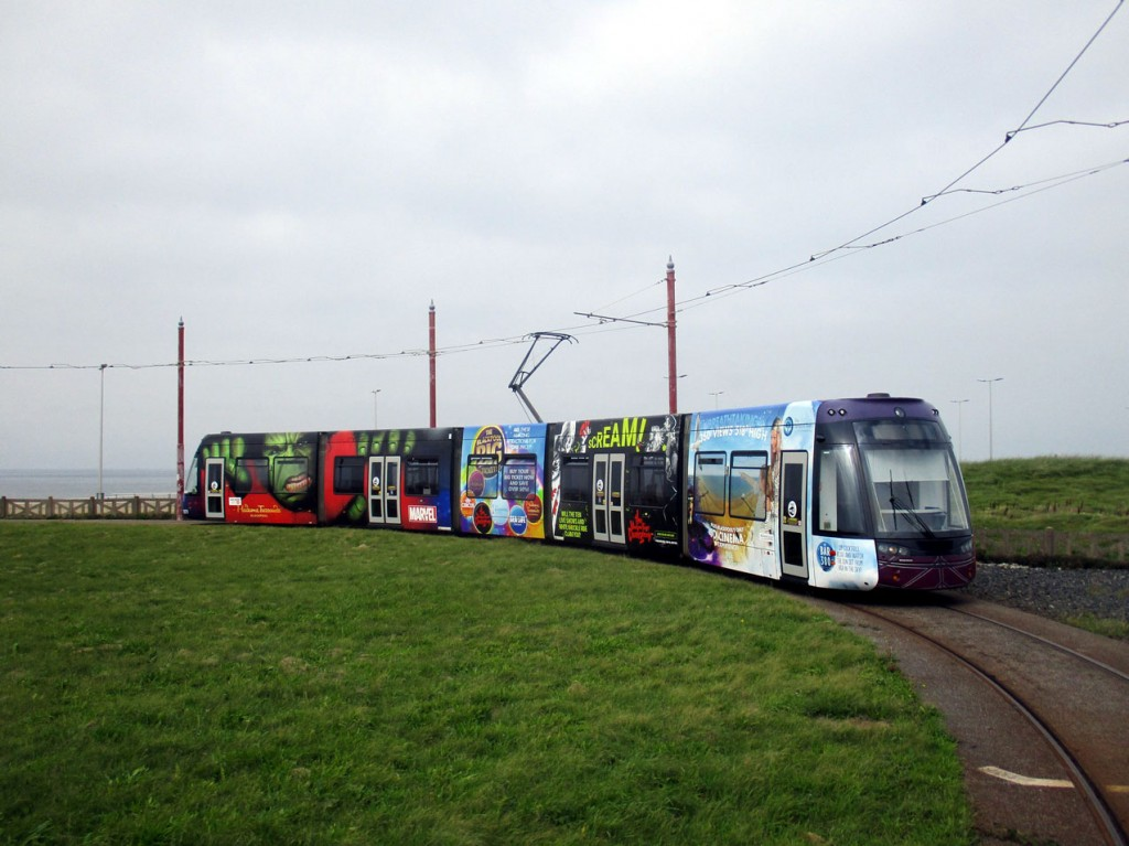 The other side of the tram is seen here on Little Bispham loop. Closest to the camera are adverts for Bar 360 and the Blackpool Dungeon with the Incredible Hulk and Madame Tussauds at the far end. (Photograph by Rob Bray)