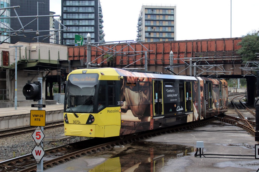 The Clarks shoes advert on 3073 is seen here. The tram is just leaving Victoria with a service to Shaw & Crompton.