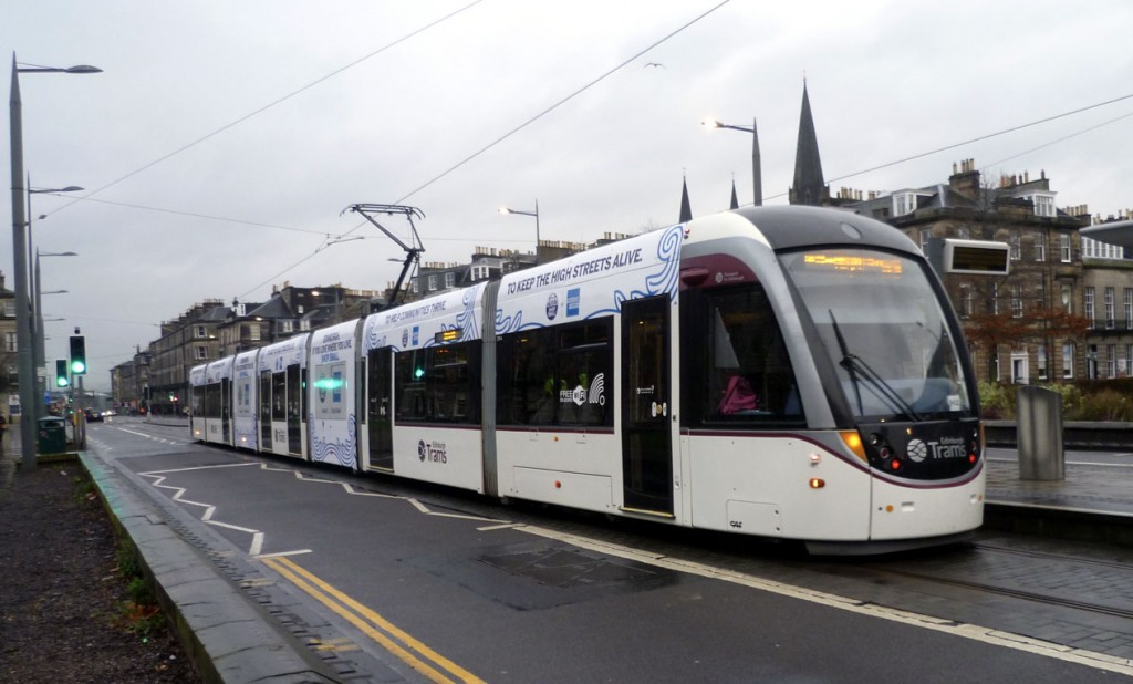 270 at West End in its new American Express advert. The tram is on its way to the Airport.