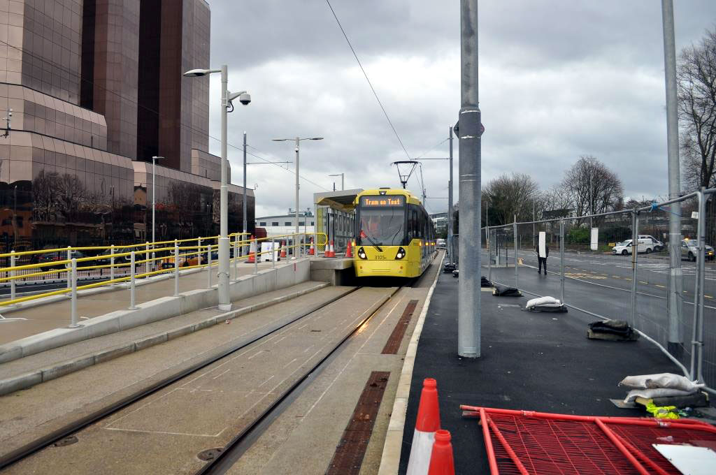 This photograph taken at IWMN (Imperial War Museum North stop on Trafford Wharf Road shows 3105 arriving at the stop from Pomona on the way to a press release event at the Trafford Centre.